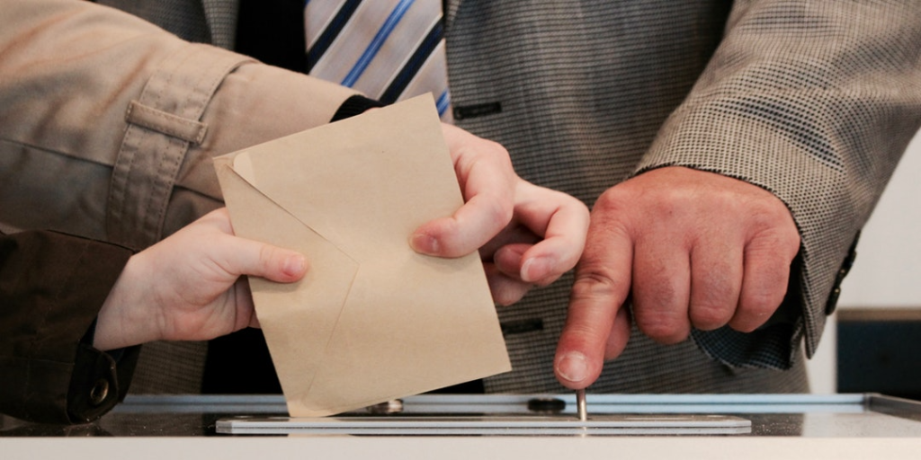 A person casting their vote. Older people opinions