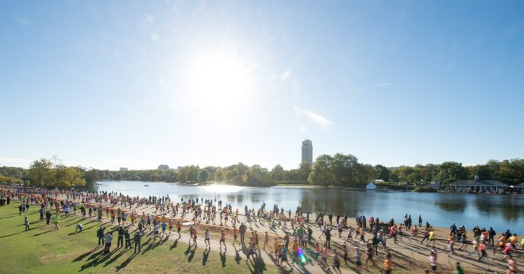 Hundreds of runners taking part in the Royal Parks Half Marathon run along the river bank