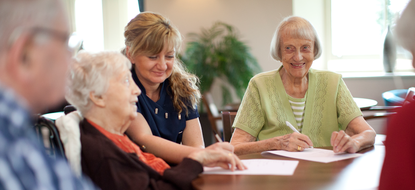 Older people having a table discussion.